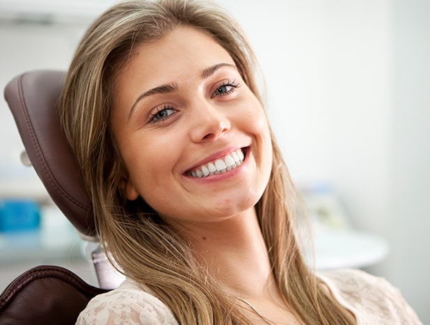 Woman smiling in the dental exam chair