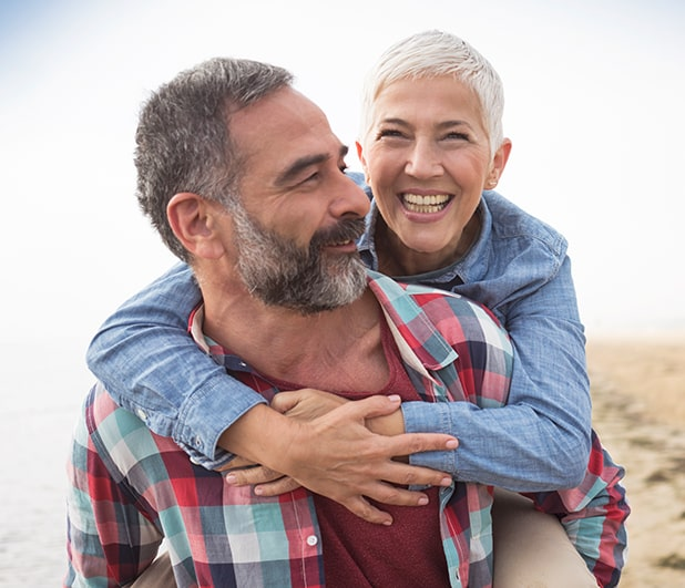 Couple smiling during piggyback ride