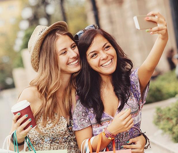 Two women smiling taking a selfie