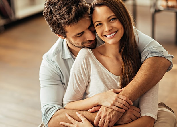 Young couple smiling indoors