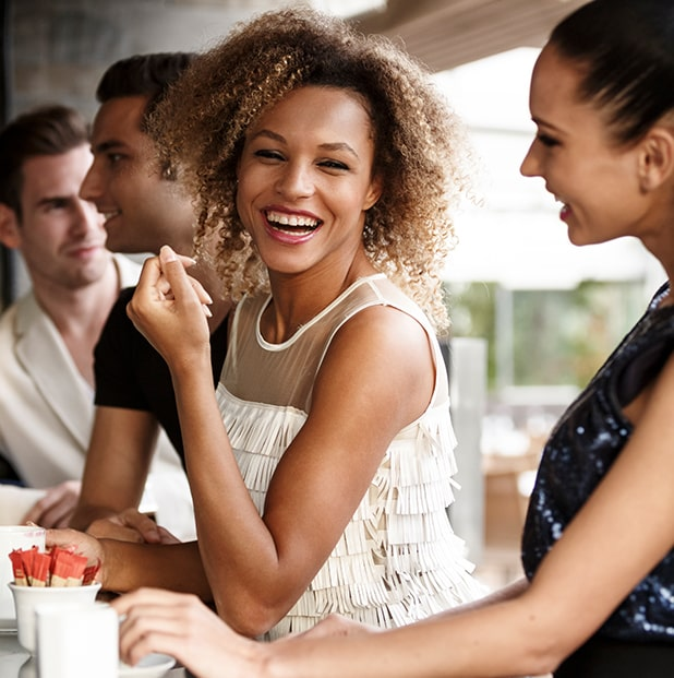 group of young people smiling at a restaurant