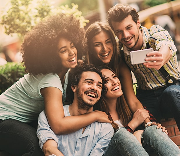 group of friends smiling while taking a picture