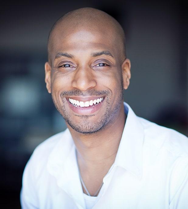 black man smiling with white teeth